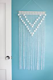 Small Picture Pom Pom Wall Hanging A Beautiful Mess Walls