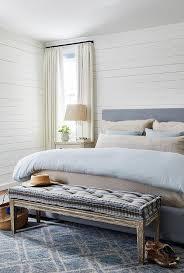 blue headboard with tan nightstands