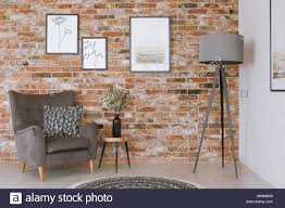 Red brick furniture Redbrick Mill Closeup Photo Of Gray Furniture Against Red Brick Wall With Simple Nature Inspired Posters Redbrick Mill Closeup Photo Of Gray Furniture Against Red Brick Wall With Simple