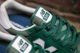 new balance green. the new balance 520 appears in green and red colorways t