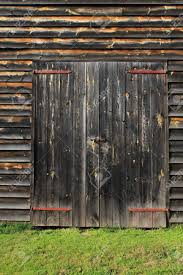 old barn door background. barn door background - closed doors on a farm building, with old weathered wooden 8