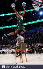 Utah Jazz Jeremy Evans jumps over teammate Gordon Hayward sitting in a  chair as he competes in the slam dunk contest during the NBA All-Star  weekend in Orlando, Florida, February 25, 2012.