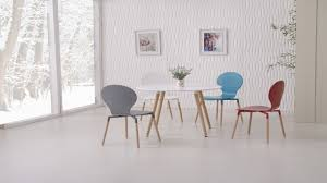 round wooden white dining table and 4 mixed coloured chairs white round dining room table and