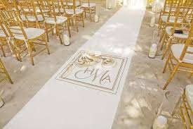 12 pictures of cool wedding aisle runners mywedding Unique Wedding Aisle Runner white and gold monogrammed aisle runner at beach wedding unique wedding aisle runners