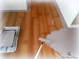 painting laminate floors need to do this in my bedroom and sewing room would look great