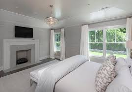 White and Gray Bedroom with Gray Stone Fireplace and Flat panel TV