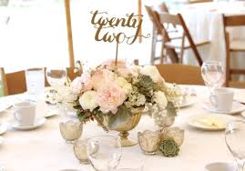 gold mercury glass centerpiece with garden roses kiera and white ranunculus strata astilbe and babies