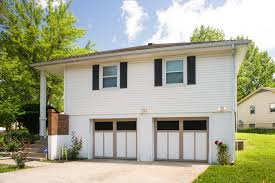 The Dangers of Replacing a Garage Door Spring | Door Systems, Inc ...