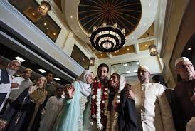 the bride and groom groom samir mohamedy 30 center in garland with his bride henna abowath 28 right and family members are in a festive mood after