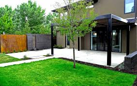 modern concrete patio. Large Steel And Wood Arbor Over Patio In Modern Poured Concrete Water Feature