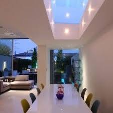 skylight lighting. as large a skylight possible over dining table with integrated lighting john cullen h