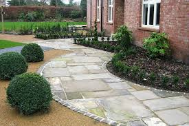 curved stone walkways designs for homes mixed with sweet small garden facing brick wall house with white wooden framed windows plus garden fence