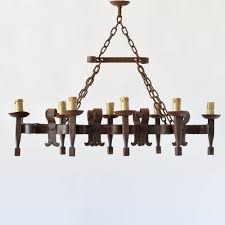 eongated french iron chandelier with forged candelholders and scroll decorations