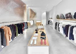 MRQT Boutique is a minimalist interior located in Stuttgart, Germany,  designed by ROK.