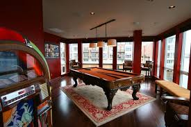 Game room rug family room eclectic with juke box wood flooring oriental rug