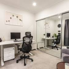 contemporary home office chairs. This Is An Example Of A Mid-sized Contemporary Home Office In Melbourne  With White Chairs