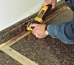 how to cut laminate countertop for corner sink a the back from top or bottom