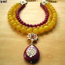 designer fashion jewellery necklace set with red kundan pendant for women