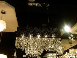 a black rectangular shade with see thru pattern houses lovely shaped dangling clear glass