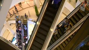 people on escalators. escalator 4k shopping mall crowd of people buy shop center centre last minute sale sales purchases on escalators