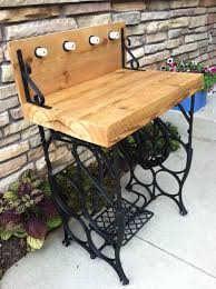 sewing machine base table. This is more of an outdoor style bar table but  could work in the right room