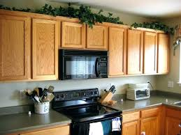 decorating ideas for above kitchen cabinets. Decorating Above Kitchen Cabinets Fake Plants Cabinet Ideas For O