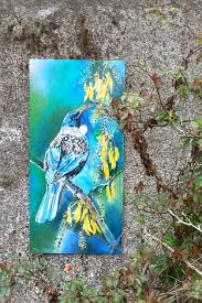 new zealand tui bird feeding on kowhai tree nectar filled flowers outdoor garden patio on outdoor wall art new zealand with new zealand tui bird feeding on kowhai tree nectar filled flowers