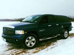 Blue A 2005 Dodge Ram 1500 Bighorn 4x4 With A 6ft Bed And A Sleek Tinted Camper Shell The Rear Passenger Windows A Truck Bed Storage Chrome Rims Panel Truck