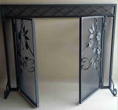 wrought iron fireplace screen with doors