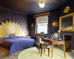 pink and purple bedroom with a wall of gold room decor and design