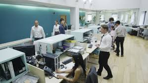 group contemporary office. attractive young multi ethnic group working together as a team in busy modern office or contemporary r