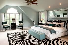 splashy zebra print rug in bedroom traditional with bedroom decoration next to blue bedroom alongside bedroom carpet and black furniture