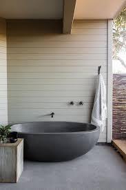 outdoor bathroom with gray tub