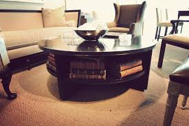 round black coffee table with storage bookshelf underneath a gallery of gorgeous round coffee tables