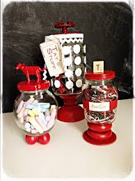 i painted white dots on the big jam jar a racing stripe on the little jar and just left the round cow jar plain i added tags so that my little