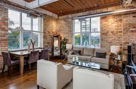 living and dining room with exposed brick walls design the graces remax hallmark