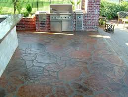 stone flooring idea over concrete design with outdoor kitchen with modern set with reddish accent and