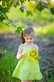 Photo Of Cute Little Girl Sitting On Green Grass On Backyard And Cute Small Girl