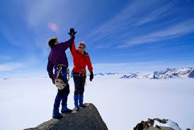 can goals and to do lists actually lead to self sabotage top of mountain high five accomplishment goal