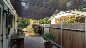 james created this wall mounted deck canopy to offer shade over his grill and outdoor cooking space since this is a wall mounted canopy it is more