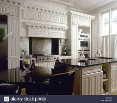 Traditional Kitchen With White Painted Decorative Moulding Black