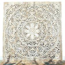 large carved wood panel