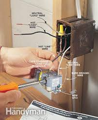 how to install gfci outlets the family handyman photo 2 strip the wires