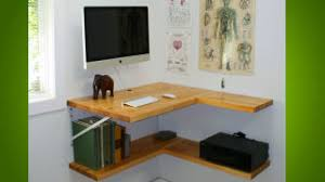 Today's featured workspace is an elegant, custom-built desk that makes  smart use of available space by hanging everything on the wall.