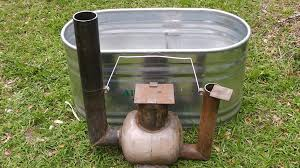 generation of unlimited hot water 100 off the grid without electricity by converting an old propane tank to burn underwater as an immersion heater for