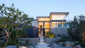 new home lighting. The Front Of This Modern House Has A Path Surrounded By Landscaping, That Leads To New Home Lighting