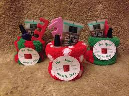 co worker holiday gifts take a pair of socks and roll them up then add nail polish foot scrub and toe separators so easy and cute