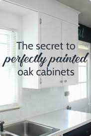 step by step tutorial for painting oak cabinets white including the best way to get rid