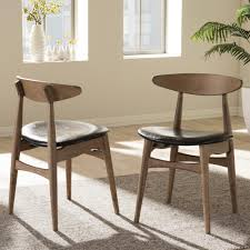 black wood dining chair. Baxton Studio Flora Black Faux Leather And Medium Brown Wood Dining Chairs (Set Of 2 Chair T