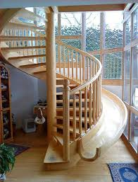 beautiful wooden spiral stairs with a slide integrated